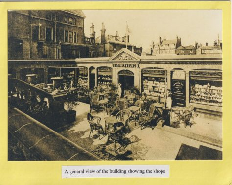 Photograph of a general view of the building showing the shops